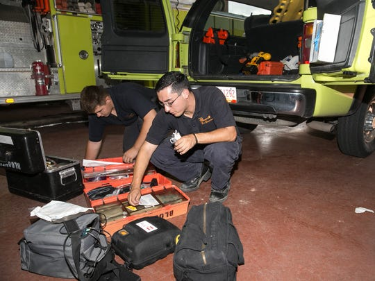 Volunteer firefighters CJ Barker, left, and Chris Garcia restock supplies at the Bloomfield Fire Department Main Station on Wednesday.