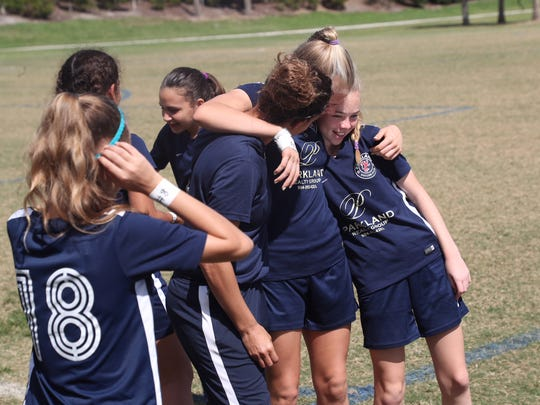 The soccer teammates of Alyssa Alhadeff listen to the
