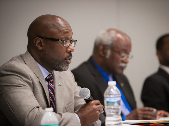 Delaware's Democratic candidates for Senate District 2, from left, Bobby Cummings, Sam Guy and Darius J. Brown hold a public debate at the Route 9 Library and Innovation Center in New Castle.