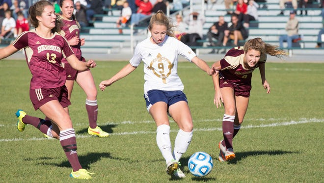 Cathedral's #9, Audey Kleiman dribbles through the crowed for a goal during Girls High School Regionals, at Zionsville Youth Soccer Association, Wednesday October 14th, 2015. Brebeuf defeated Cathedral 3 to 1.