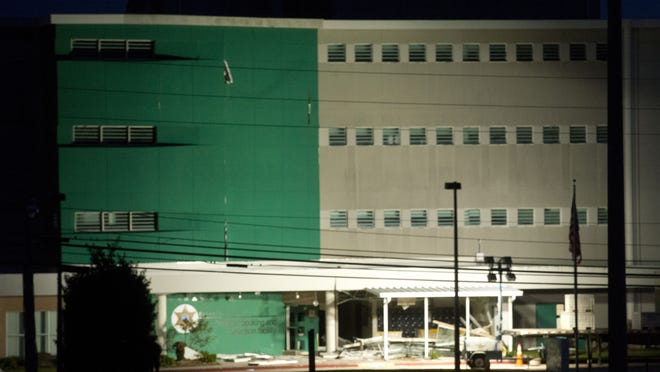 Escambia County officials said a portion of the county's insurance claim on the severely damaged jail Central Booking and Detention facility has been denied.