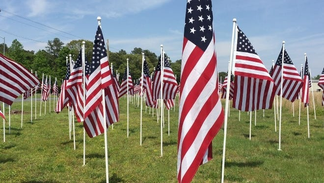 """This May 24, 2016 photo shows a display of about 500 flags at the intersection of Hobbs Road and eastbound Route 50 next to Arthur Perdue Stadium in Salisbury. At 2 p.m., on Monday, May 30, a dedication ceremony gets underway at the intersection and includes the opening of the """"Field of Honor."""""""