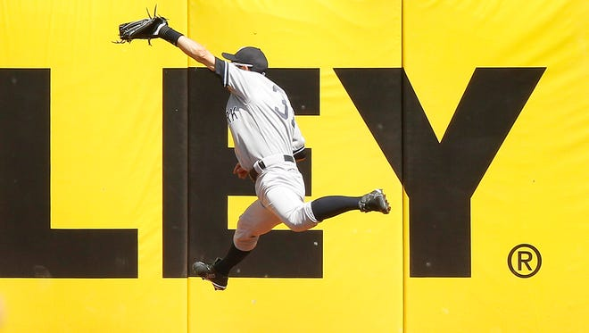 Yankees right fielder Ichiro Suzuki makes a leaping catch against the Oakland Athletics in the fourth inning at O.co Coliseum on Sunday. The Athletics defeated the Yankees 10-5. Mandatory Credit: Cary Edmondson-USA TODAY Sports