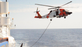 MH-60 refueling at sea as search crews cover 70,000-plus