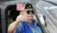A Vietnam veteran waves an American flag while riding