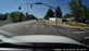 Dashboard camera shows the driver going through a red