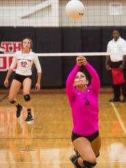 Jensen Beach's Meredith Dallas saves the ball to set