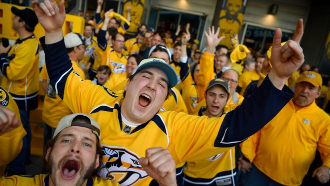 Fans celebrate after the series-clinching win in game 6 of the second round NHL Stanley Cup Playoffs at the Bridgestone Arena  Sunday, May 7, 2017, in Nashville, Tenn.