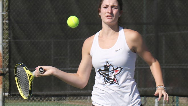 Southside's Kate Coleman returns a Springdale serve during a doubles match with playing partner Ashlyn Roffine, Thursday, Sept. 24, at Creekmore Tennis Center.