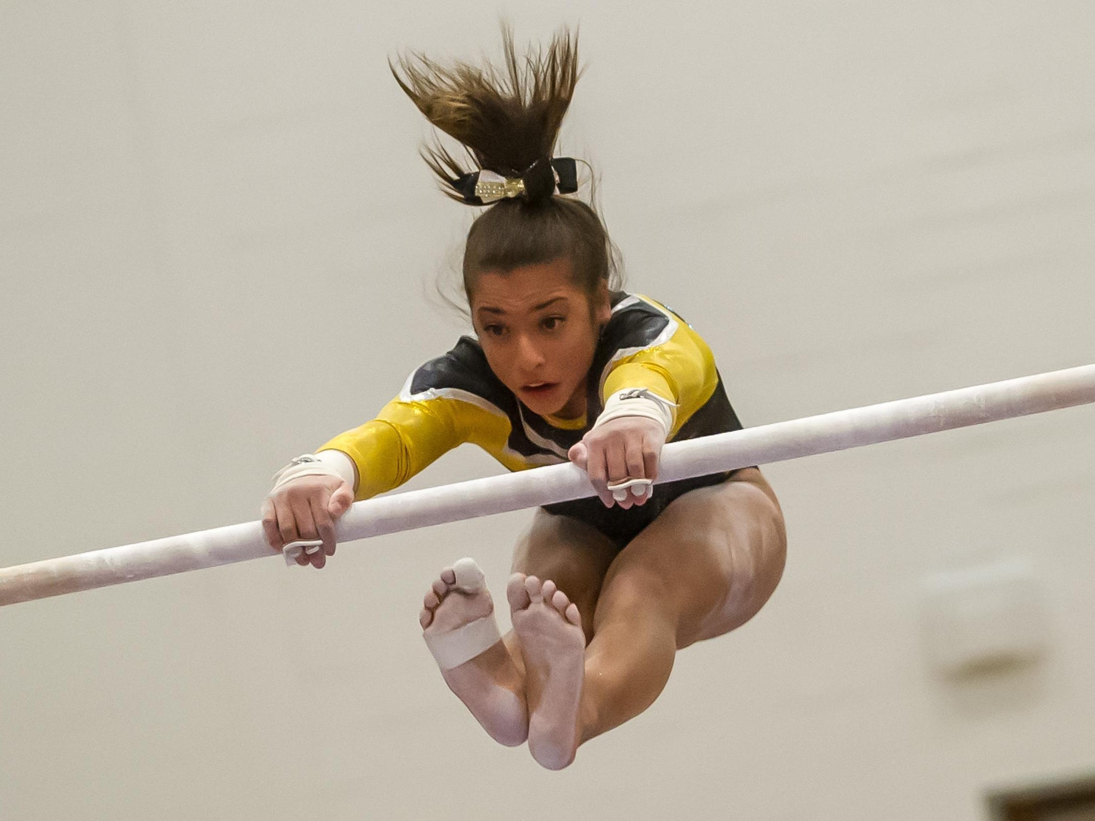 St. John Vianney's Arianna Agrapides competes on the bars in the NJSIAA Gymnastics state individual championship at Montgomery High School on Saturday Nov. 14, 2015. Photo by Jeff Granit