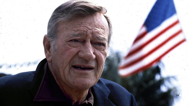 Actor John Wayne, seen here in 1978, was best known for his Western films, where he played the quintessential screen cowboy. The Orange County Airport was renamed in his memory shortly after his 1979 death, and a statue of the actor was installed at the airport in 1982.