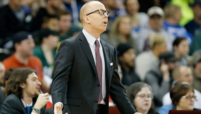 Cincinnati Bearcats head coach Mick Cronin reacts to a foul called in the second half of the NCAA Tournament first round game between the Cincinnati Bearcats and the Saint Joseph's Hawks at Spokane Arena in Spokane, Wash., on Friday, March 18, 2016. The Bearcats were eliminated from the tournament on a 78-76 loss to the Hawks.