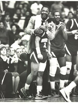 Georgetown men's basketball coach John Thompson hugs guard Horace Broadnax in this undated photo posted Monday on Twitter by Broadnax's son Trae.