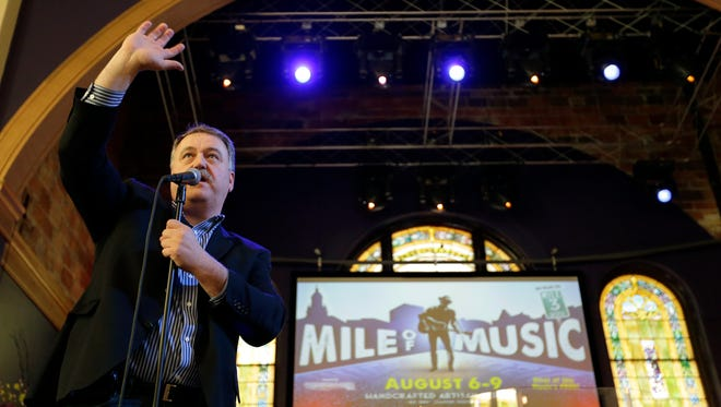 Mile of Music co-founder Dave Willems thanks the crowd for attending the Mile of Music kickoff announcement Thursday in downtown Appleton.