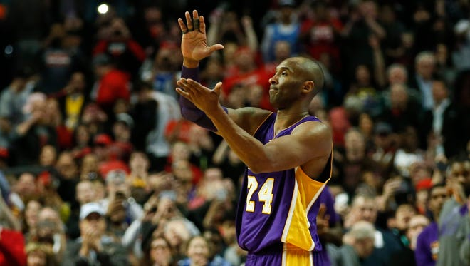 Kobe Bryant leaves the game against the Bulls during the second half at United Center.