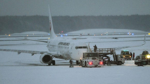 A Japan Airlines' Boeing 737 passenger plane sits on