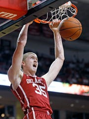 Oklahoma's Brady Manek (35) dunks the ball during an NCAA college basketball game against Texas Tech in February. This was before he transformed into Larry Bird's doppelganger.