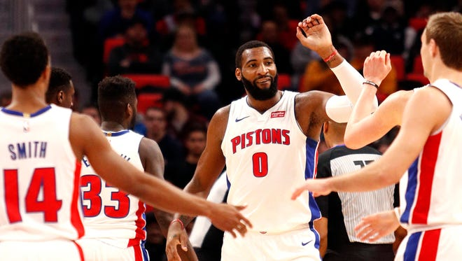 Pistons center Andre Drummond (0) celebrates with teammates after a play during the first quarter on Thursday, March 29, 2018, at Little Caesars Arena.