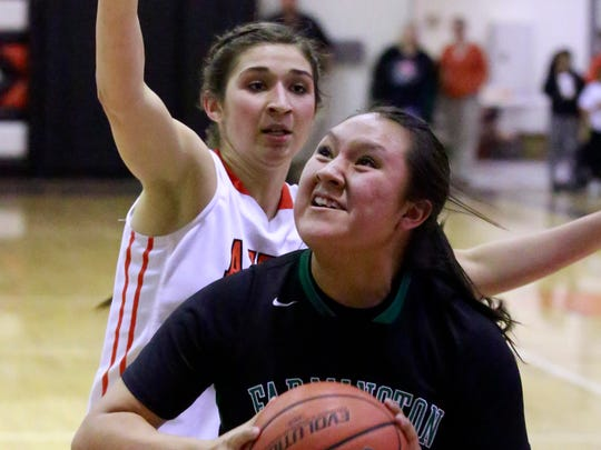 Farmington's Lyla Denny lines up a shot during a game against Aztec on Feb. 25 at Lillywhite Gym in Aztec.