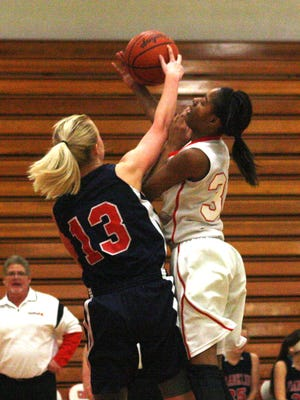 Churchill's Jaelah Rivers and Franklin's Erin McNally battle for a rebound last week.