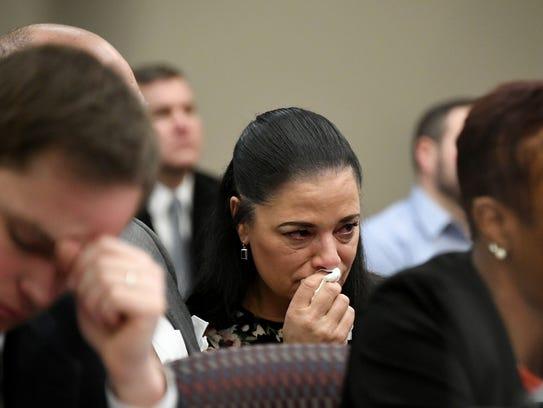 Gina Nichols, mother of victim Maggie Nichols weeps