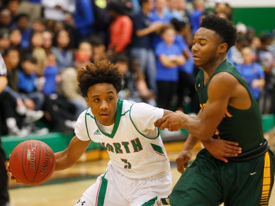 North sophomore Tyreke Locure (3) drives the ball past Hoover sophomore Kenny Quinn (1) Friday, Jan. 6, 2017 during their game at North High School in Des Moines.