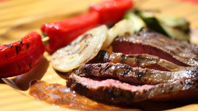 Marinated flat iron steak with grilled vegetables.