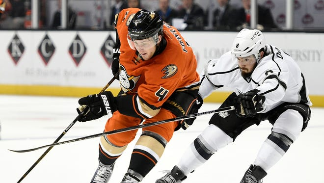 Anaheim Ducks defenseman Cam Fowler, left, moves the puck against the Los Angeles Kings on Feb. 28, 2016.