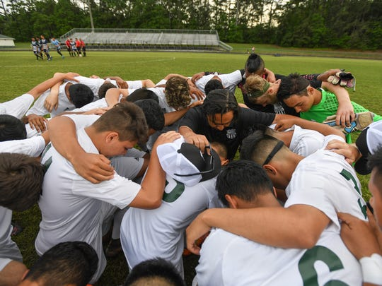 Berea head soccer coach Karl Casida brings his team together before their AAA playoff match against Newberry on Wednesday, May 3, 2017.