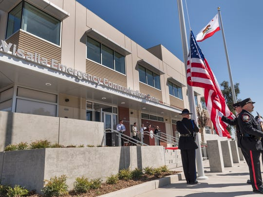 The Visalia Police & Fire Honor Guard raises the flag on the City's new Emergency Communications Center on Wednesday, September 20, 2017 during the ribbon cutting ceremony.
