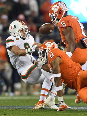 Clemson safety Isaiah Simmons (11) breaks up a pass intended for Miami wide receiver Braxton Berrios (8) during the 1st quarter of the ACC championship game against Miami at Bank of America Stadium in Charlotte on Saturday, December 2, 2017.