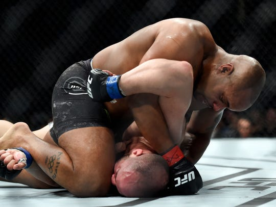 Daniel Cormier fights Volkan Oezdemir during UFC 220
