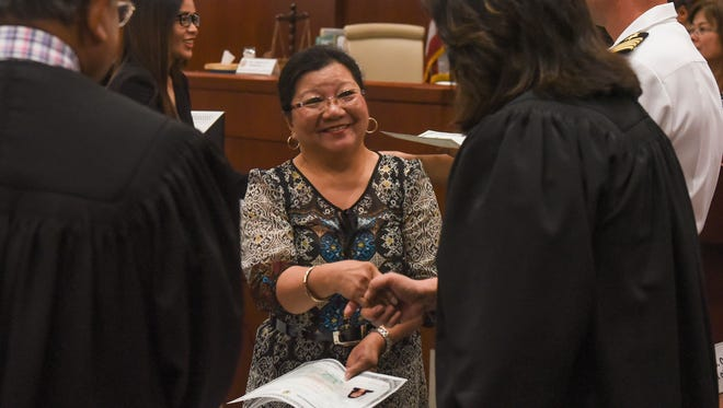 Newly naturalized citizens are congratulated after receiving their certificates during a naturalization ceremony at the District Court of Guam in Hagåtña on July 3, 2017.