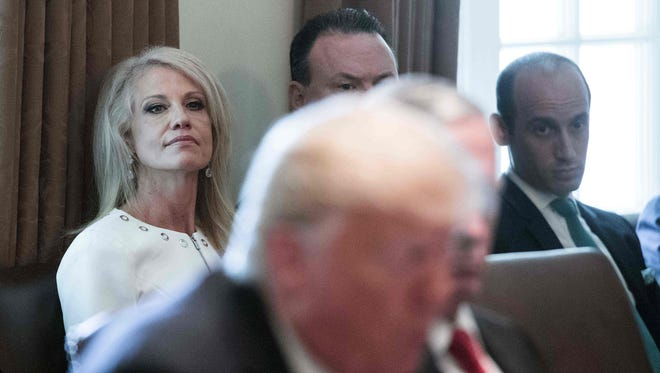 Top White House aides Kellyanne Conway and Stephen Miller attend a cabinet meeting at the White House in Washington, DC, on June 12, 2017.