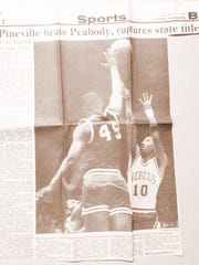 The photo on The Town Talk's front Sports page of March 11, 1990, shows Pineville senior point guard Ray Washington (10) shooting a jump shot over Peabody's Eric Hayward in the Class AAA boys title game the night before.