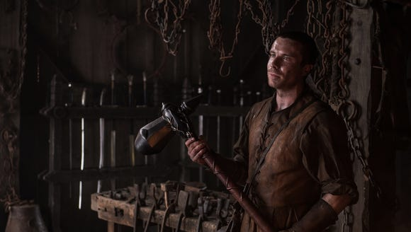 Gendry wields a war hammer, just like his father, Robert