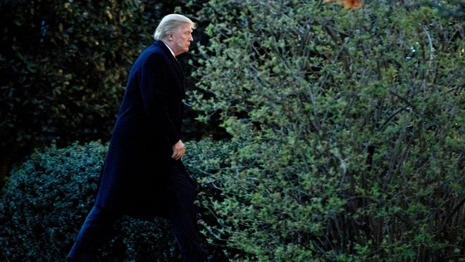 President Trump walks to the Oval Office upon arrival at the White House on March 5, 2017, from a trip to Florida.