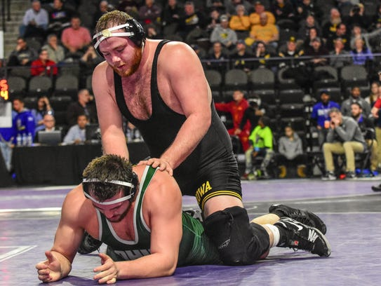 Iowa's Sam Stoll works his top offense against Ohio's