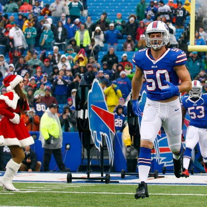 Buffalo Bills middle linebacker Kiko Alonso (50) runs on the field before a game against the Miami Dolphins at Ralph Wilson Stadium.