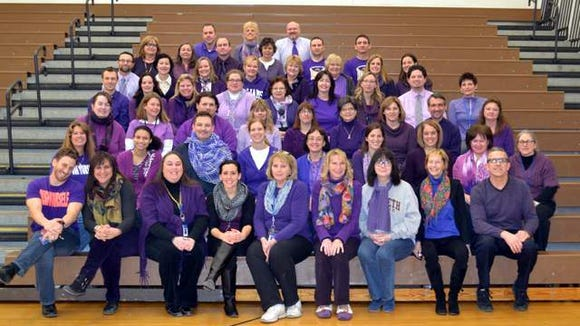 Staff of Webster Schroeder High School shows their purple.