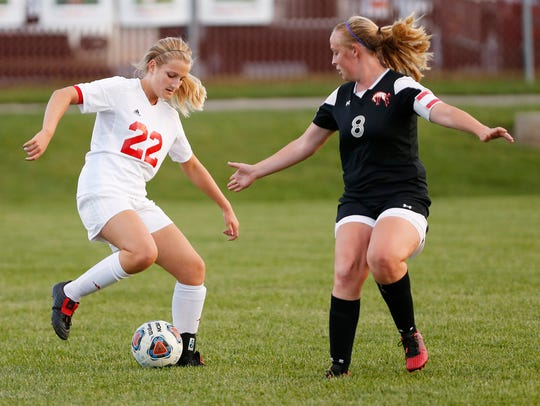 West Lafayette's Aleah Whaley works to keep the ball