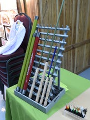 A display of collapsible fishing rods sits on the table