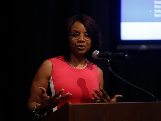 Towanda Davila-Davis, shown at the 25 Women You Need to Know banquet, will host  Cancer Knock Out Foundation's 6th Annual Survivor's Symposium  on Sept. 7.
