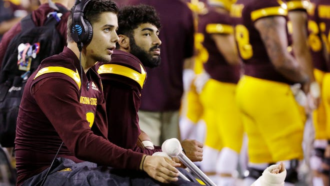 Arizona State's Manny Wilkins (right)  sits with Brady White on the sideline during the game against Washington State on Saturday, Oct. 22, 2016 in Tempe.