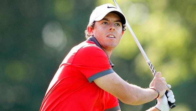 Rory McIlroy hits his tee shot on the 18th hole during the first round of the Memorial Tournament at Muirfield Village Golf Club Thursday. He leads the field.