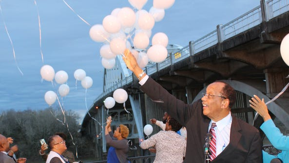 Selma Mayor George Evans joins in a balloon release