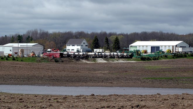 Manure hauling and planting equipment was idled last week by another spat of cold weather and rain that left water standing in most Wisconsin fields.