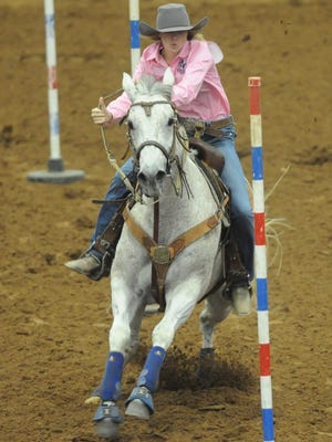Abilene's Hannah Hammond and her horse, Jenyus, compete in the first pole bending go-round Tuesday, June 6, 2017 during the Texas High School Rodeo Association's State Finals at the Taylor County Coliseum.