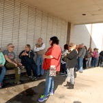Shoppers wait in line for pre-Black Friday shopping at J.C. Penney  in the Greentree Mall in Clarksville, Ind.  Nov. 26, 2015