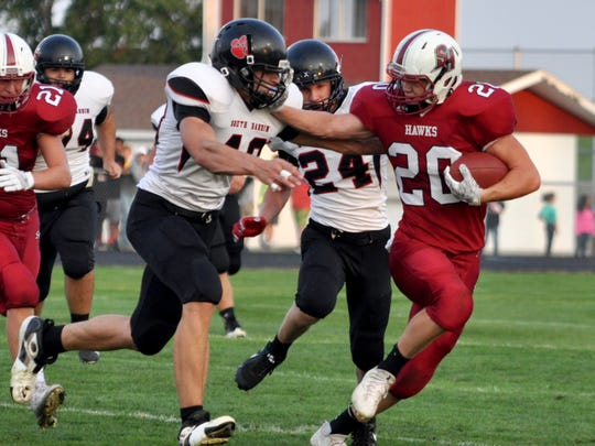 Iowa commit Logan Klemp (No. 20) fends off a defender in South Hamilton's Week 1 game versus South Hardin last fall.